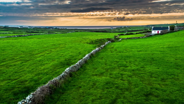 Flight over an old stone wall in rural landscape in Ireland video