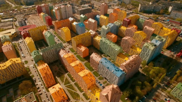 Flight over cozy comfortable colored houses in a European city 4K UHD aerial video