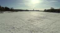 Flight over  frozen lake in  winter. Aerial video
