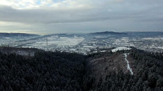Flight over hills in winter, mountain range on horizon video