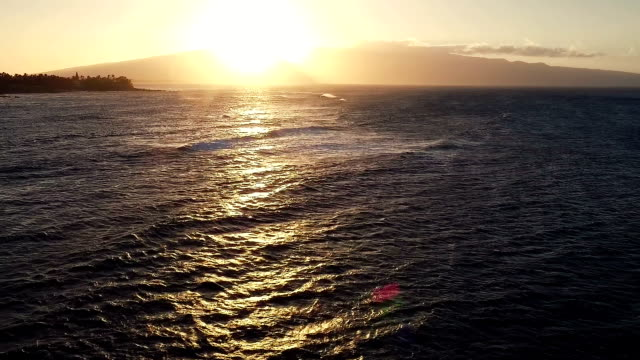 Flight Over Ocean Waves at Sunset. Amazing Sunset Aerial Ocean View video