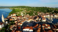 Flight over old city Piran, aerial panoramic view with old houses, roofs, St. George's Parish Church, Tartini Square, fortress and the sea. Slovenia. video