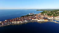 Flight over old city Piran, aerial panoramic view with St. George's Parish Church, Tartini Square, fortress and the sea. Slovenia. video