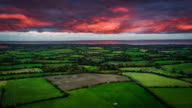 Flight over patchwork landscape with fields and farms in Ireland video