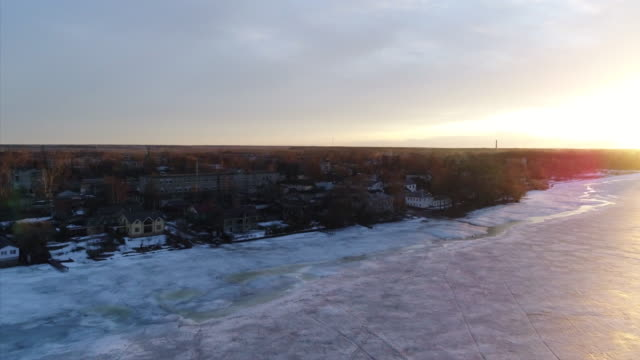 Flight over the frozen river to the city video