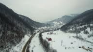 Flight over the Mountain Road and River in Winter video