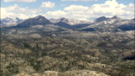 Flight Passing Wooded Hills With Wind River Mountains In Background  - Aerial View - Wyoming,  Sublette County,  helicopter filming,  aerial video,  cineflex,  establishing shot,  United States video