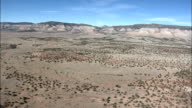 Flight Past Narrow Mountain Range  - Aerial View - New Mexico,  Cibola County,  United States video