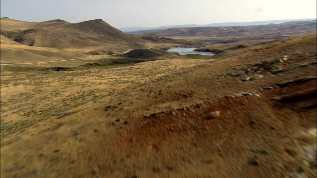 Flight Past Orchard Reservoir On Upper NoWood Road  - Aerial View - Wyoming, Washakie County, United States video