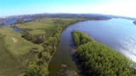 Flight with decrease over  river and trees. Aerial video