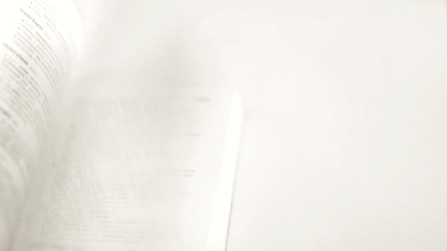 Flipping a book on white background. video
