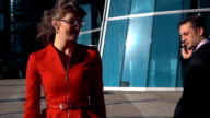 Flirting of a business people outdoors video