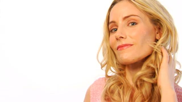 Flirty Blond Female on White Background a video
