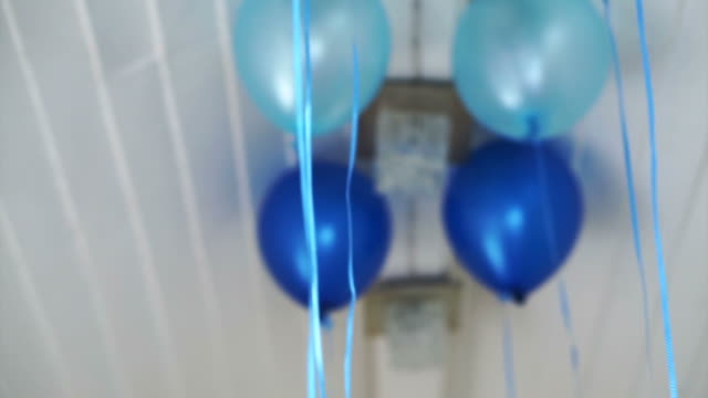 Floating blue party ballon indoor video