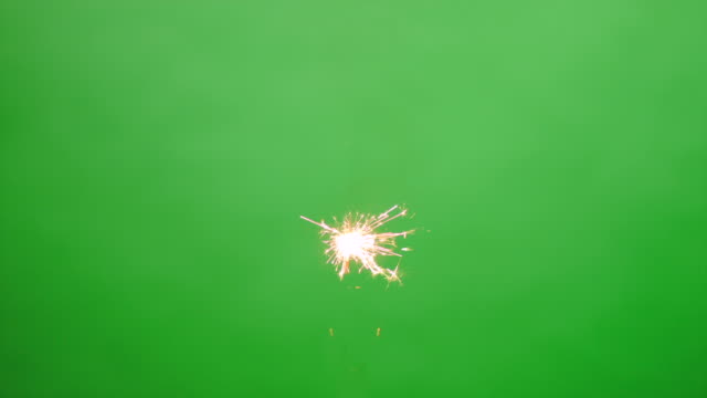 Floating burning sparkler on green screen HD video