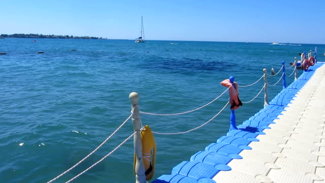 Floating pier near the sea, yachting, sailing, summer outdoor activities video