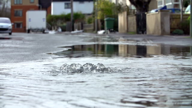 Flood Water Escaping From Drain Cover In Slow Motion video