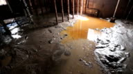 Flooded basement man walks through thick mud HD video