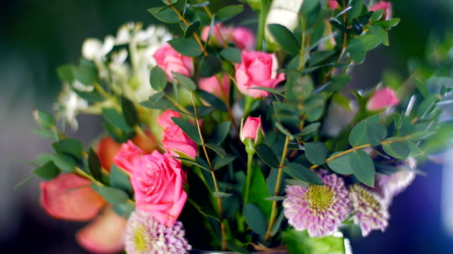 floral composition against the backdrop of greenery video