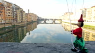 florence italy puppet Pinocchio walking to the left on ponte vecchio video