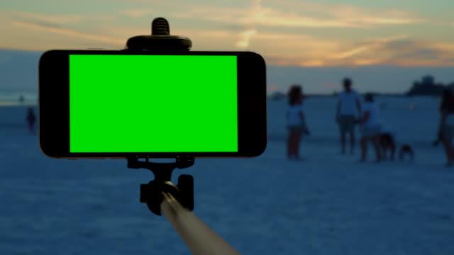 Florida beach smart phone chromakey green screen selfie stick people video
