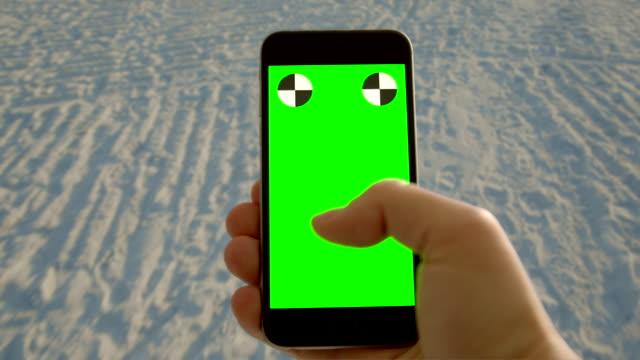 Florida beach smart phone chromakey green screen texting surfing net Florida beach video