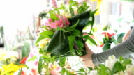 Florist Arranging Bouquet Of Alstroemeria video