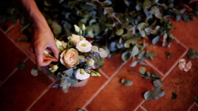 Florist at work. Woman making beautiful bouquet video