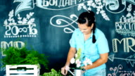 Florist at work: woman making fashion modern bouquet of different flowers video