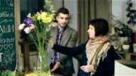 Florist is giving a master class on creating bouquets. video
