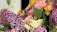 Florist makes a beautiful bouquet from different flowers video