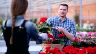 Florist with flower basket at greenhouse video