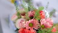 flower arrangement bouquet standing in vase on table inside room video