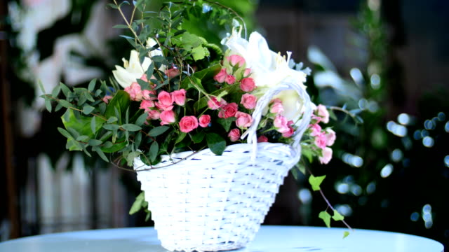 Flower bouquet in the rays of light, rotation, consists of Amaryllis white, Rose lydia, Santini , cineraria, eucalyptus, Ivy roomy, Barbatus, feverweed, Cymbidium orchid video