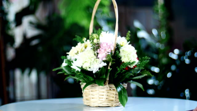 Flower bouquet in the rays of light, rotation, the floral composition in a basket consists of Clove pistachio, Chrysanthemum anastasis, solidago, Russus video