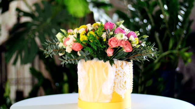 Flower bouquet in the rays of light, rotation, the floral composition consists of Rose david austin, Rose cream grace, Rose barbados, Eustoma, Santini , Ornithogalum, eucalyptus video