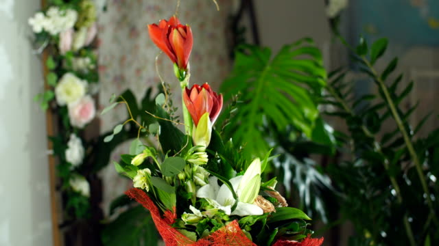 Flower bouquet in the rays of light, rotation, the floral composition consists of Amaryllis ferrari, aspidistra, eucalyptus, Barbatus, Russus, Alstroemeria, lily, Rose video