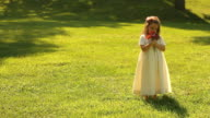 Flower Girl Sways in the Grass video