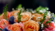 A flower shop offers a variety of flowers and bouquets video