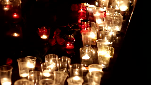 Flowers and candles at the memorial in honor of the victims of the victims of the terrorist attack. Consequences of the terrorist attack, military operations. People mourn and mourn the dead video