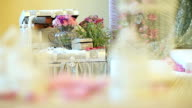 Flowers and trunk and candlesticks. Dynamic change of focus. Close up video