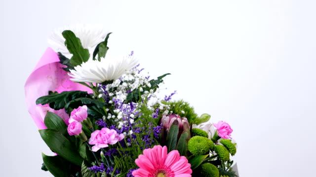 Flowers, bouquet, rotation on white background, floral composition consists of Chrysanthemum anastasis, gypsophila, solidago, Barbatus, Protea, Carnation, gerbera video