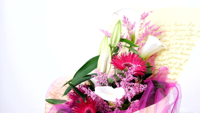 Flowers, bouquet, rotation on white background, floral composition consists of solidago calla, lily, Gerbera terry Russus video