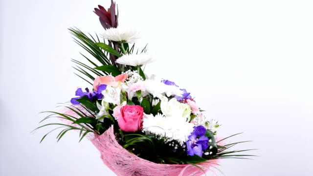 Flowers, bouquet, rotation on white background, floral composition consists of Leucadendron, Chrysanthemum anastasis, Amaryllis pink, Orchid vanda, Alstroemeria video