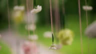 Flowers hanging on strings in forest in wedding day outdoors video