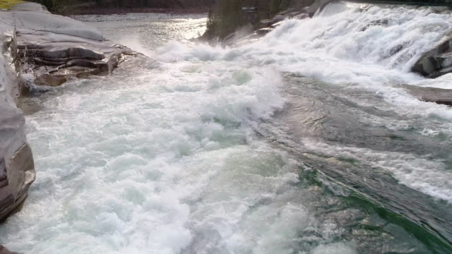Flowing Over the Waters Edge in Slow Motion from Drone Floating Low Above Waterfall video