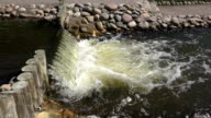 flowing ripply waterfall at rocky shore video