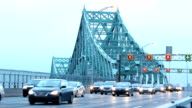 Flowing traffic on Montreal Jacques-Cartier bridge at dawn HD video
