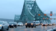 Flowing traffic on Montreal Jacques-Cartier bridge at dawn Zoom out version HD video