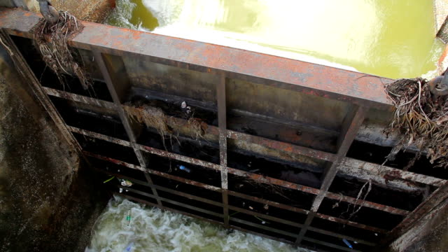 Flowing water at floodgate video